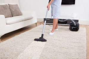 Residential cleaner vacuumin a carpet